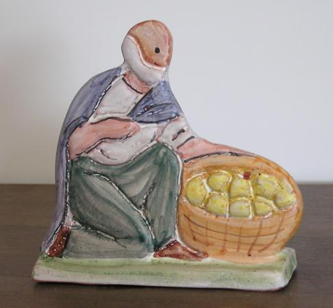 Shepherd with a basket of oranges